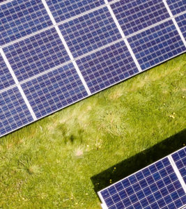 Third part of solar panels in meadow